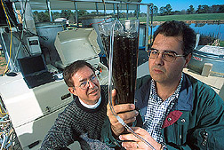 Soil scientists Patrick Hunt (left) and Matias Vanotti examine nitrifying pellets. Click the image for additional information about it.