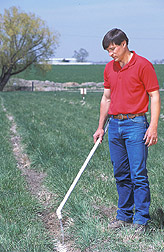 Agricultural engineer demonstrates a PAM application method: Click here for full photo caption.