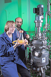 Nancy Nichols and Bruce Dien add yeast to a bioreactor to begin ethanol fermentation. Link to photo information