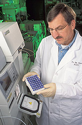 Physiologist prepares a tray of cow plasma extracts.
