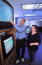 Photo: Hydrology engineer Jurgen Garbrecht and meteorologist Jeanne Schneider interpret the latest seasonal climate forecast issued by NOAA's Climate Prediction Center. Link to photo information
