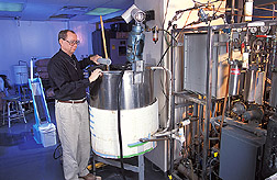 Chemical engineer prepares to test fermentability of corn: Click here for full photo caption.
