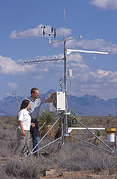 Technician and manager of Network site reset weather recording equipment: Click here for full photo caption.