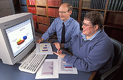 Research psychologist and postdoctoral fellow review data: Click here for full photo caption.