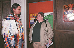 Champion grass dancer talks with postdoctoral fellow about American Indian health study: Click here for full photo caption.