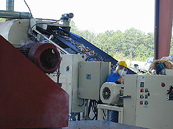 Conveyor system used to transport and prepare army garbage: Click here for full photo caption.