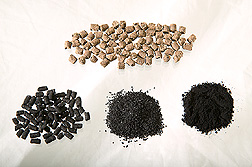 Photo: Series of samples illustrating poultry manure pellets, activated carbon pellets, granular activated carbon and powdered activated carbon. Link to photo information