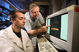 Technician and geneticist identify a mutant DNA: Click here for full photo caption.
