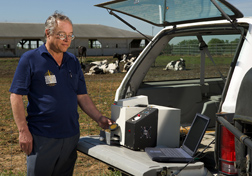Chemist analyzes manure for nitrogen in the field using a prototype near-infrared filter spectrometer: Click here for full photo caption.