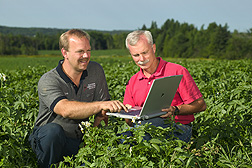A Maine potato grower and member of the executive committee for the National Potato Council (left) and ARS agricultural economist field test the Potato Systems Planner to identify the crop rotation sequence that minimizes disease and maximizes profit: Click here for full photo caption.