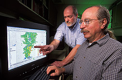 Photo: ARS agronomist George Mueller-Warrant (front) and hydrologist Jerry Whittaker look at map of conservation practices in the Calapooia River watershed. Link to photo information