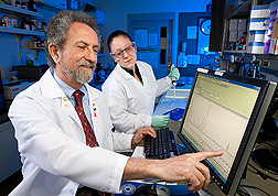 Nutritional biochemist (left) and research assistant examine dietary antioxidants in a sample of human plasma measured by high-performance liquid chromatography: Click here for full photo caption.