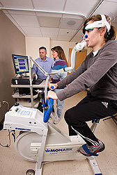 Physiologists examine results of University of California-Davis clinical specialist's calorie consumption and fat oxidation while she test-rides a cycle ergometer: Click here for full photo caption.