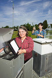Photo: ARS chemists Cathleen Hapeman (left) and Laura McConnell inspect air and rain sampling equipment. Link to photo information