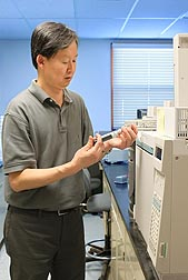 Entomologist Yong-Biao Liu injects fumigant samples into a gas chromatograph to determine phosphine concentrations: Click here for full photo caption.