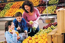 Many U.S. kids eat more servings of fruits than vegetables, but most eat less of each than they should: Click here for photo caption.