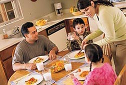 Proactive actions, such as creating a home environment where kids are likely to see and be served fruits and vegetables and to see a parent enjoying eating fruits and vegetables, are believed to be more effective ways to get children to eat these healthful foods: Click here for photo caption.