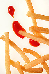 Photo: A pile of French fries with some ketchup dabs next to them. Link to photo information