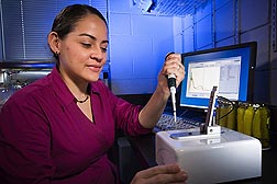 Microbiologist Ilenys Pérez-Díaz is part of an ARS team that has developed new technology that replaces as much as 80 percent of the sodium chloride in brining liquid with calcium chloride.