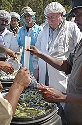 ARS chemist Roger McFeeters (second from right), who led the Raleigh laboratory from 2003 to 2011, discusses pickle making with producers in India.