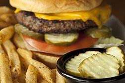 After ARS's pickle pasteurization work helped reduce spoilage in the industry, pickles became less expensive, and dill pickle slices became popular on burgers in restaurants everywhere.