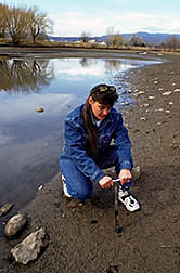 Technician Robin Montenieri collects a soil sample. Click here for full photo caption.