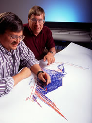 Computer specialist Ken Rojas (left) and range scientist Jon Hanson use the Root Zone Water Quality Model.