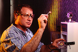 Geneticist Troy Weeks examines wheat cells after bombardment in the gene gun enclosure