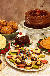 Display of bakery products--cakes, cookies, pies and other pastries. Link to photo information