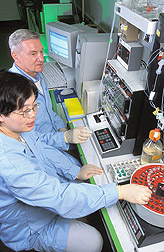 Dairy scientist and cell biologist using liquid chromatography: Click here for full photo caption.