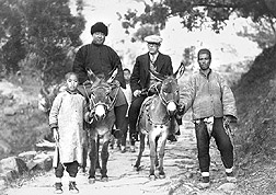 Photo: P.H. Dorsett (second from right) and his Chinese interpreter Peter Liu on the trail. Link to photo information