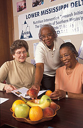 Photo: Delta NIRI Executive Director Margaret Bogle (left) and Cooperators.  Link to photo information