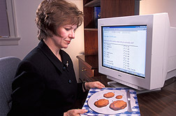 Nutritionist uses a computer to interview survey respondents: Click here for full photo caption.