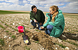 Soil scientist and technician make a quick assessment of erosion damage: Click here for full photo caption.
