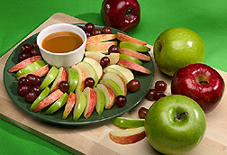 Photo: Plate of apple slices and grapes. Link to photo information