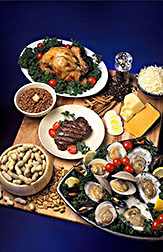 Food display that includes chicken, eggs, cheese, oysters, beef, beans and peanuts. Link to photo information
