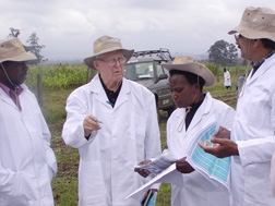Norman Borlaug (second from left) consults with Kenyan and CIMMYT leaders near wheat plots in Kenya. Link to photo information