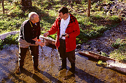 Thomas Sauer (right) and a hydrogeologist assess the flow dynamics of a natural spring:  Link to photo information