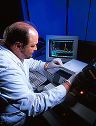 Microbiologist uses thin-layer chromatography. Click here for full photo caption.