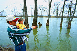 Floyd Anderson Jr., and his son check out possible fishing holes in Thighman Lake.
