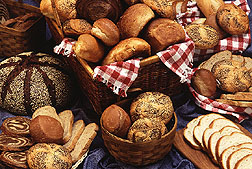 A display of various baked breads and rolls. Link to photo information