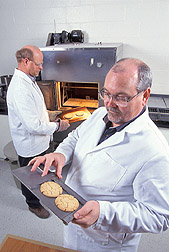 Two food technologists bake cookies for tests: Click here for full photo caption.