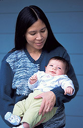 Woman holds baby: Click here for full photo caption.