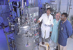 Photo: Chemist Badal Saha (left) discusses control parameters of mannitol production by fermentation with technician Greg Kennedy (center). Link to photo information