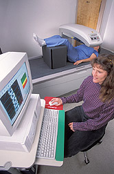 Physiologist makes a bone density measurement of a volunteer: Click here for full photo caption.