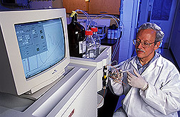 Microbiologist injects Vibrio extract into a chromatograph: Click here for full photo caption.