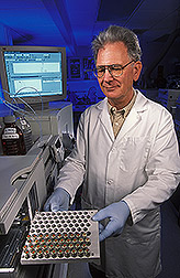 Chemist Russell Molyneux prepares walnut pellicle samples for analysis of gallic acid content. Link to photo information