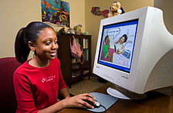 Girl at computer uses 'Food, Fun and Fitness'program. Link to photo information