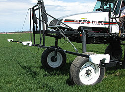 Light reflectance sensors mounted on the front of an applicator are used to measure nitrogen deficiency: Click here for full photo caption.