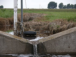 An instrumented water weir used to measure water runoff: Click here for photo caption.